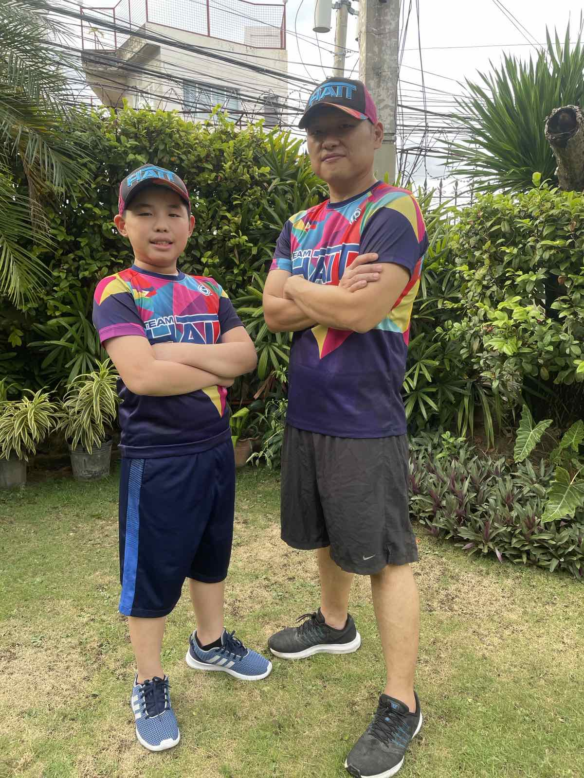 D:\ROBBY PERSONAL FILES 2013\RMA FILES\PAREF SPRINGDALE\PRESS RELEASES\PR 3\TITANS WINNERS PHOTOS\Father and Son Run - Ashton Sun (student) and Benedict Sun (dad).jpg